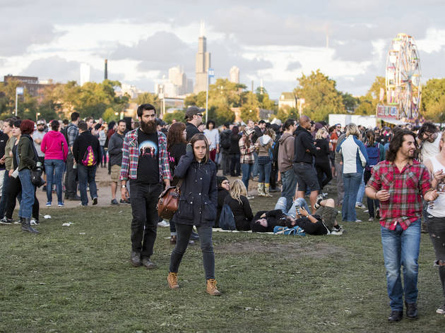 Soggy weather didn't dissuade attendees from showing up to the first day of Riot Fest, September 11, 2015.