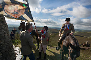 Royal Burgh Standard Bearer Martin Rodgerson and his Burleymen attendants, Three Brethren cairns summit, during the Common Riding festivities in Selkirk, Scotland, 2013 from the series Unsullied and Untarnished