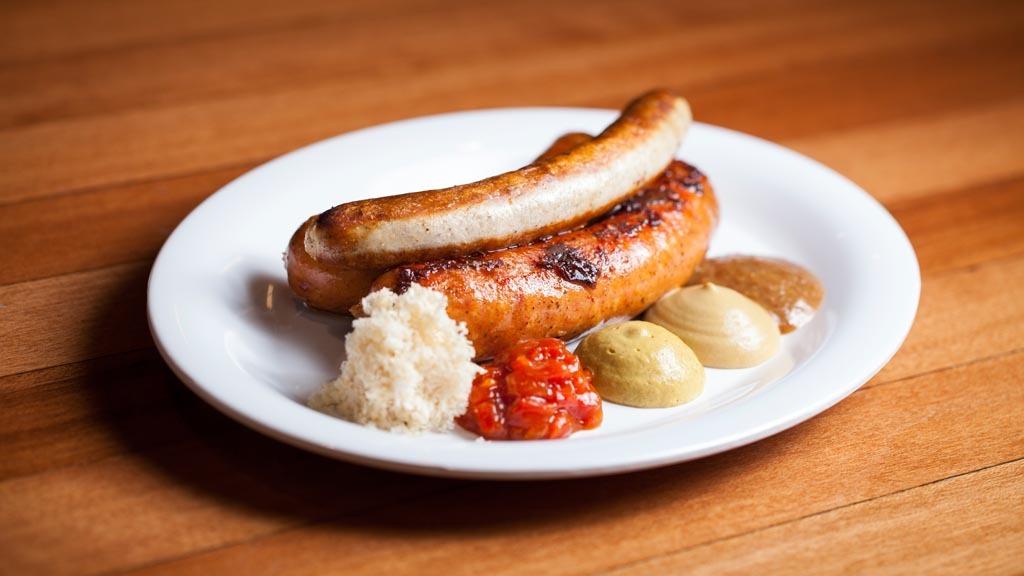 Trio sausage sampler with kaesekrainer, turkey bratwurst, and Hu