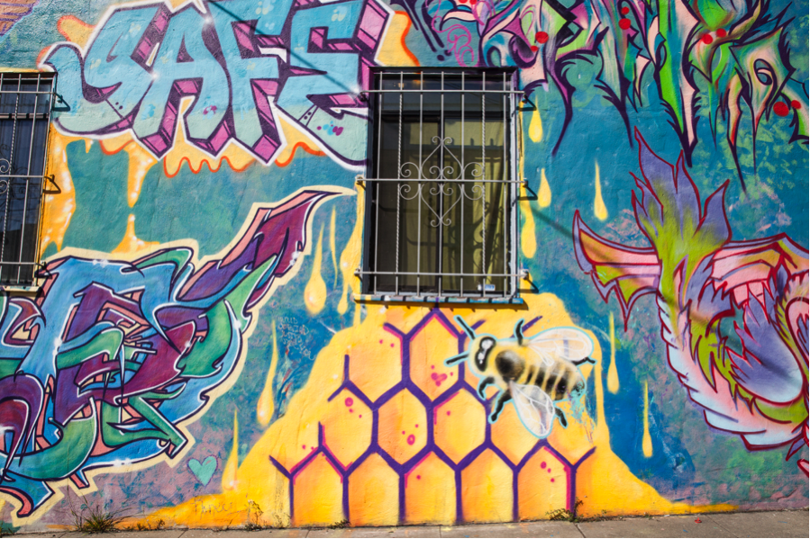 Busy bees on Taraval Street, graffiti in San Francisco