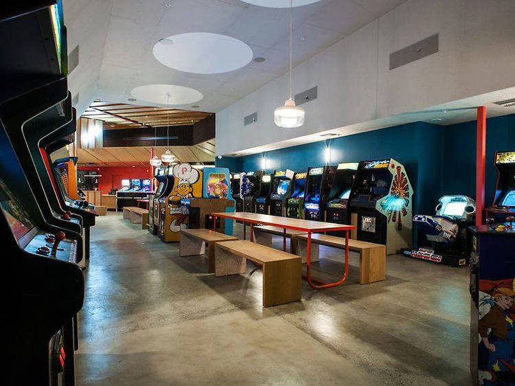 Grab a bite and play arcade games at Button Mash
