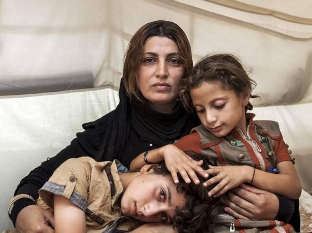 ('Amira and her Children', September 2014. © Ivor Prickett/UNHCR/Panos Pictures)