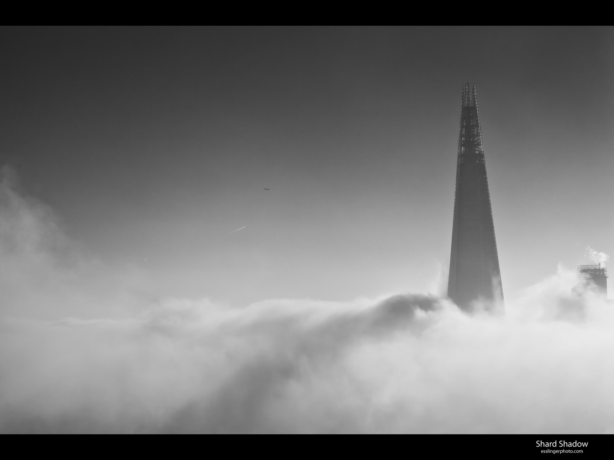 The Shard casts a long shadow over London fog.