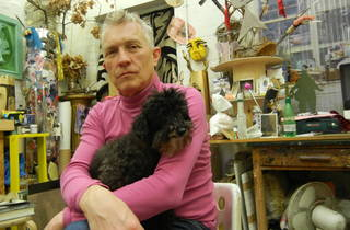 (David Harrison in his studio with Harrison, the Toy Poodle)