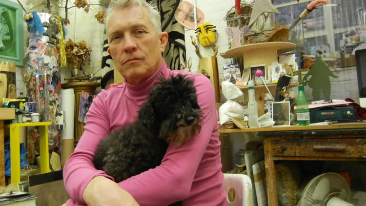 David Harrison in his studio with Harrison, the Toy Poodle