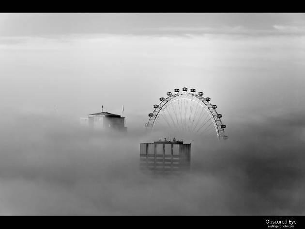 The London Eye, as seen on a foggy day.