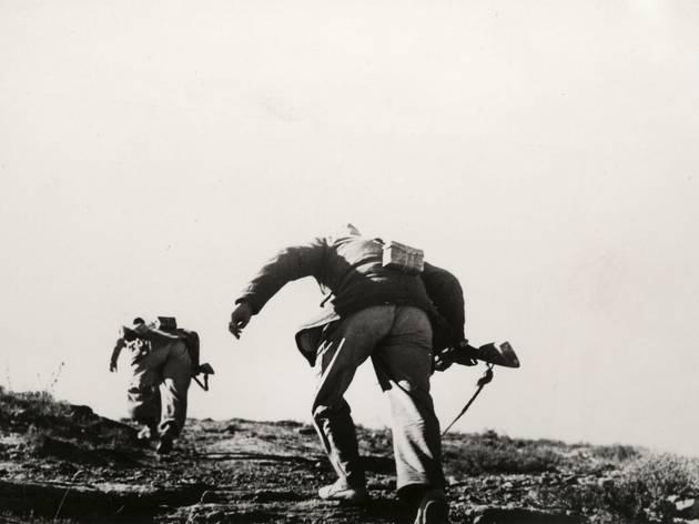(Robert Capa, Loyalist Soldiers Running Up Hill, Battle of Rio Segre, Aragon Front, 1938)