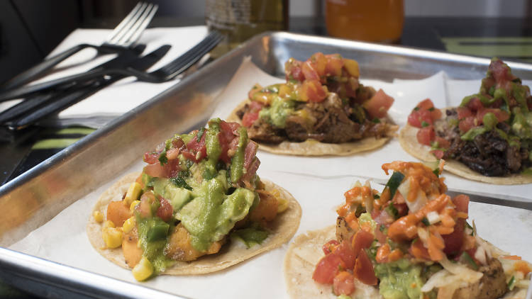 Tray of tacos - brisket, fish, vegetable (butternut squash) and carnitas