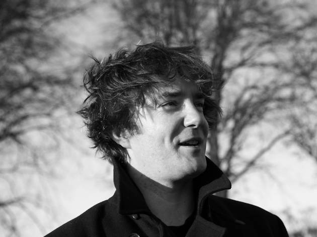 A black-and-white profile picture of Irish comedian Dylan Moran