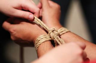Wrists being bound together with rope at Melbourne Rope Dojo