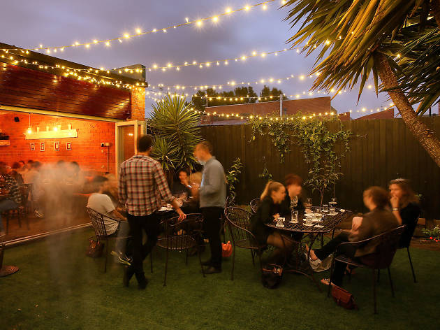 Outdoor area at Le Bon Ton with fairy lights