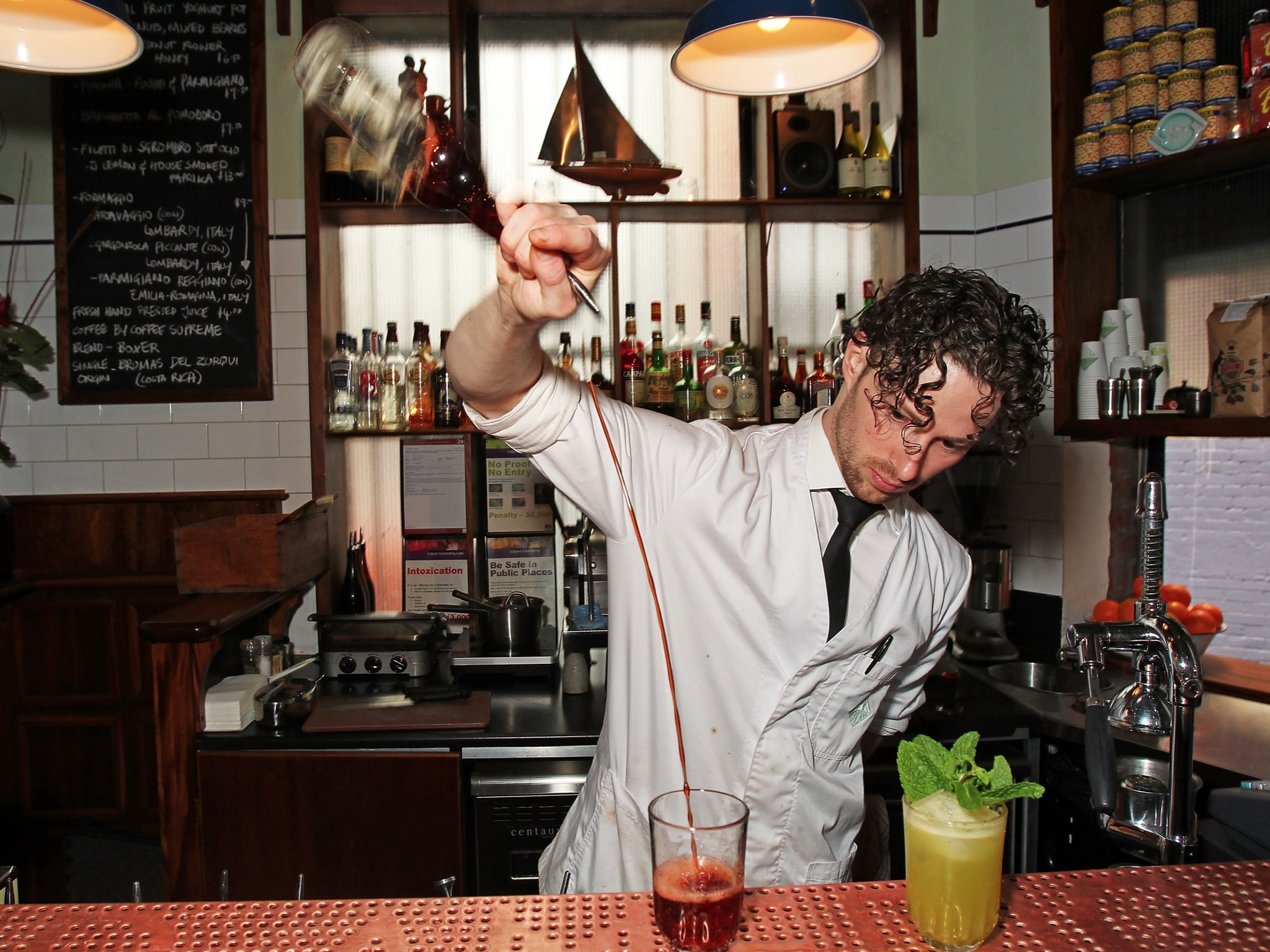 Bartender making cocktails at Bar Americano
