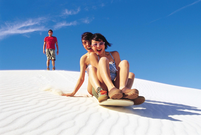 Slide down sand dunes