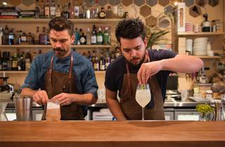 Owners Luke Ashton and Charlie Ainsbury behind the bar making co