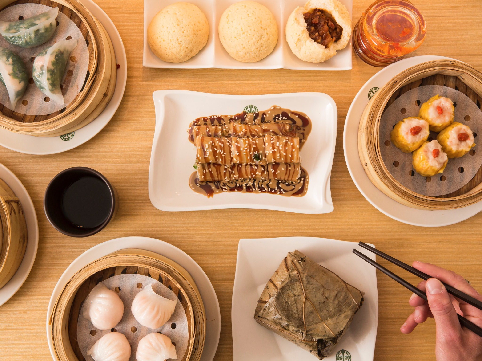 A top down table shot of a selection of food from Tim Ho Wan. A