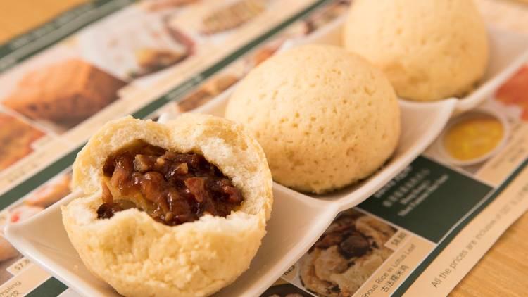 A shot of three baked buns with BBQ Pork at Tim Ho Wan