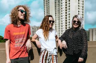 Andy Webb, Adi Toohey and Carly Roberts of Picnic chill on a rooftop