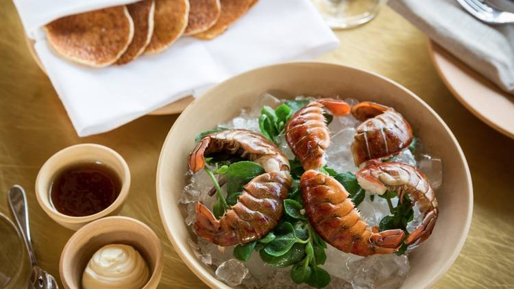 A bowl of yabbies sitting on top of a bed of salt bush and ice a