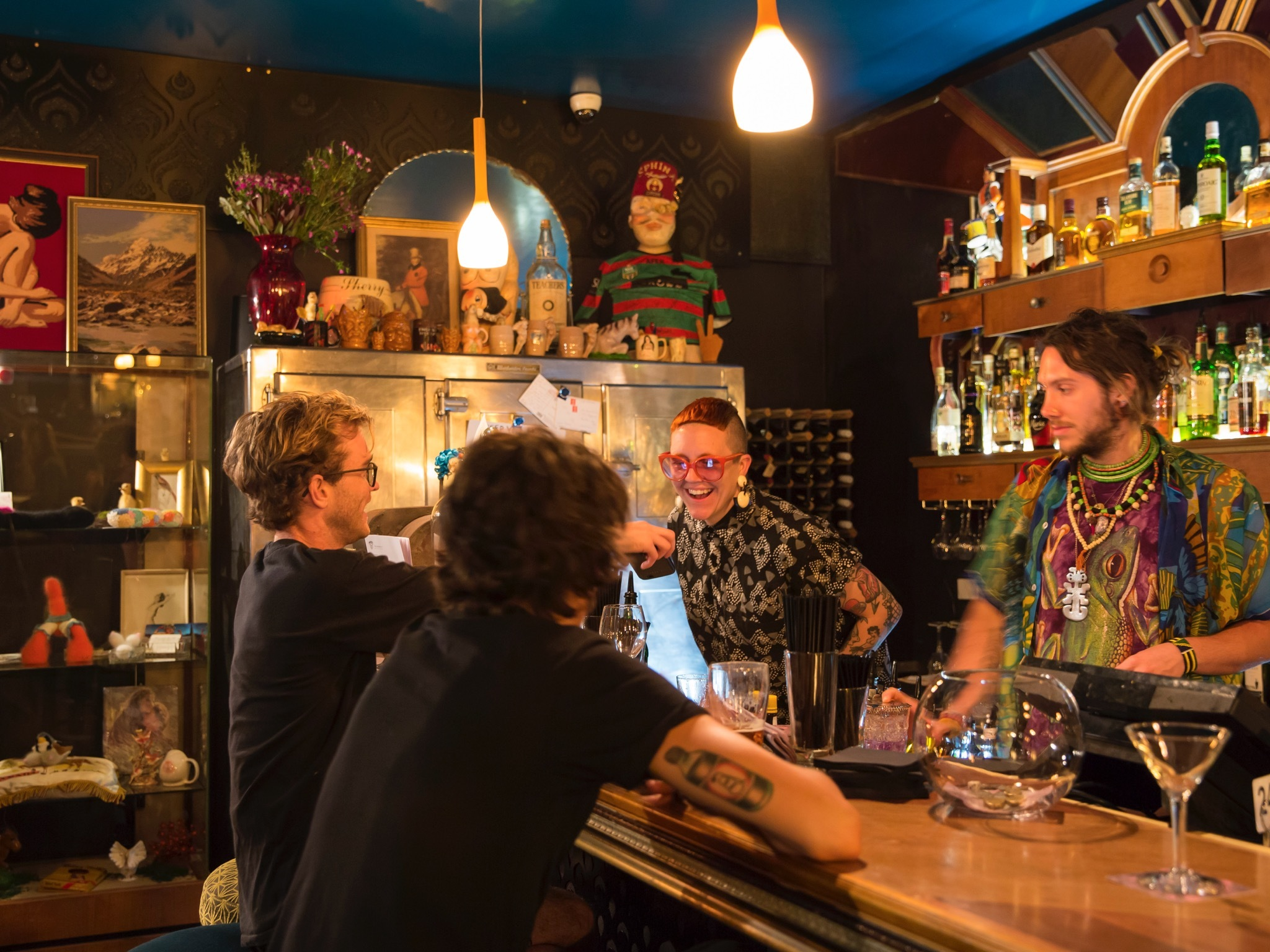 A shot of two bartenders behind the bar at The Bearded Tit