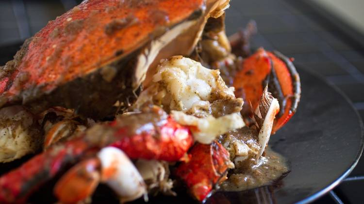 Crab cooked in black pepper and butter sauce
