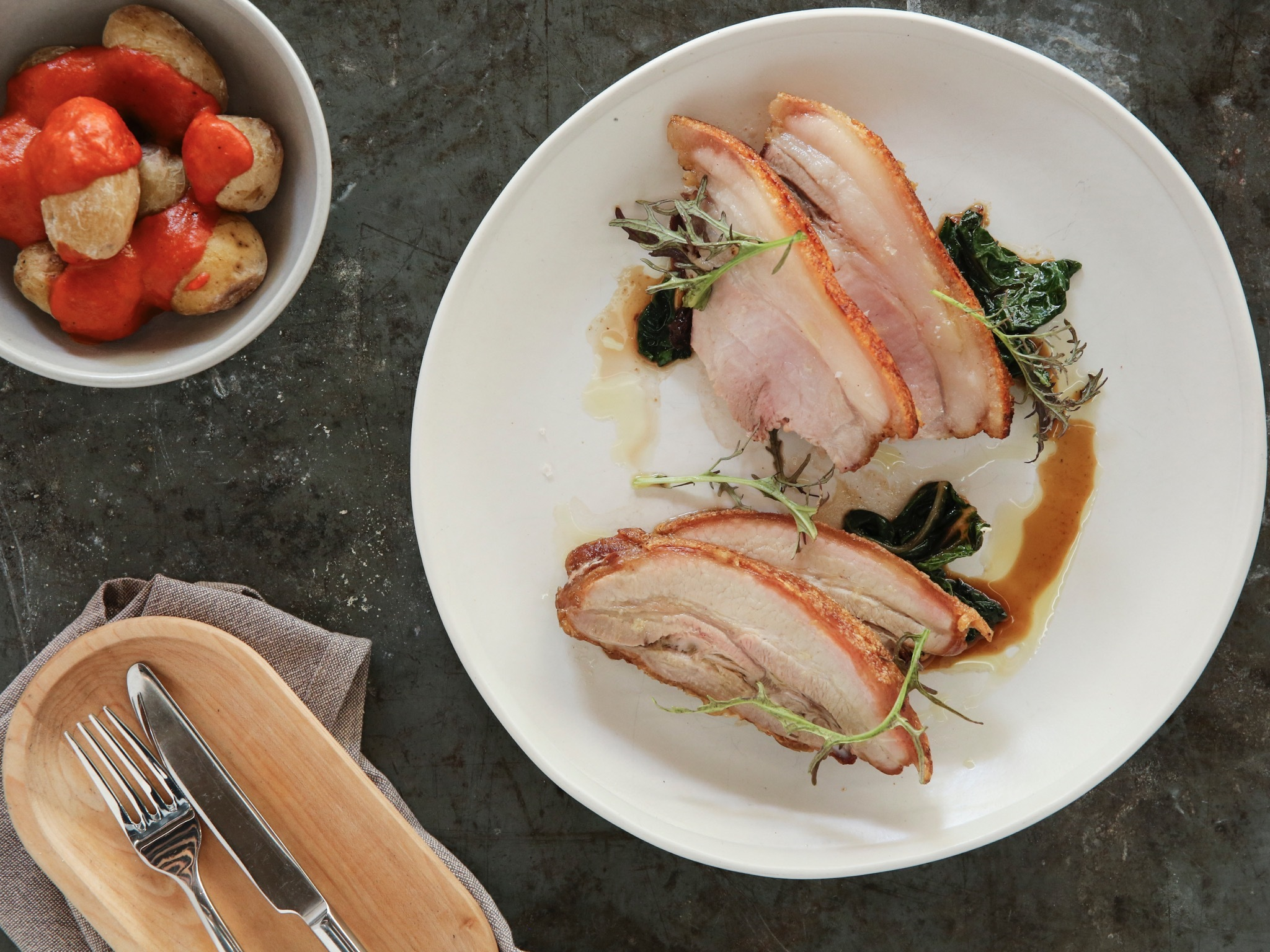 A top down shot of the wood roasted pork at Nomad