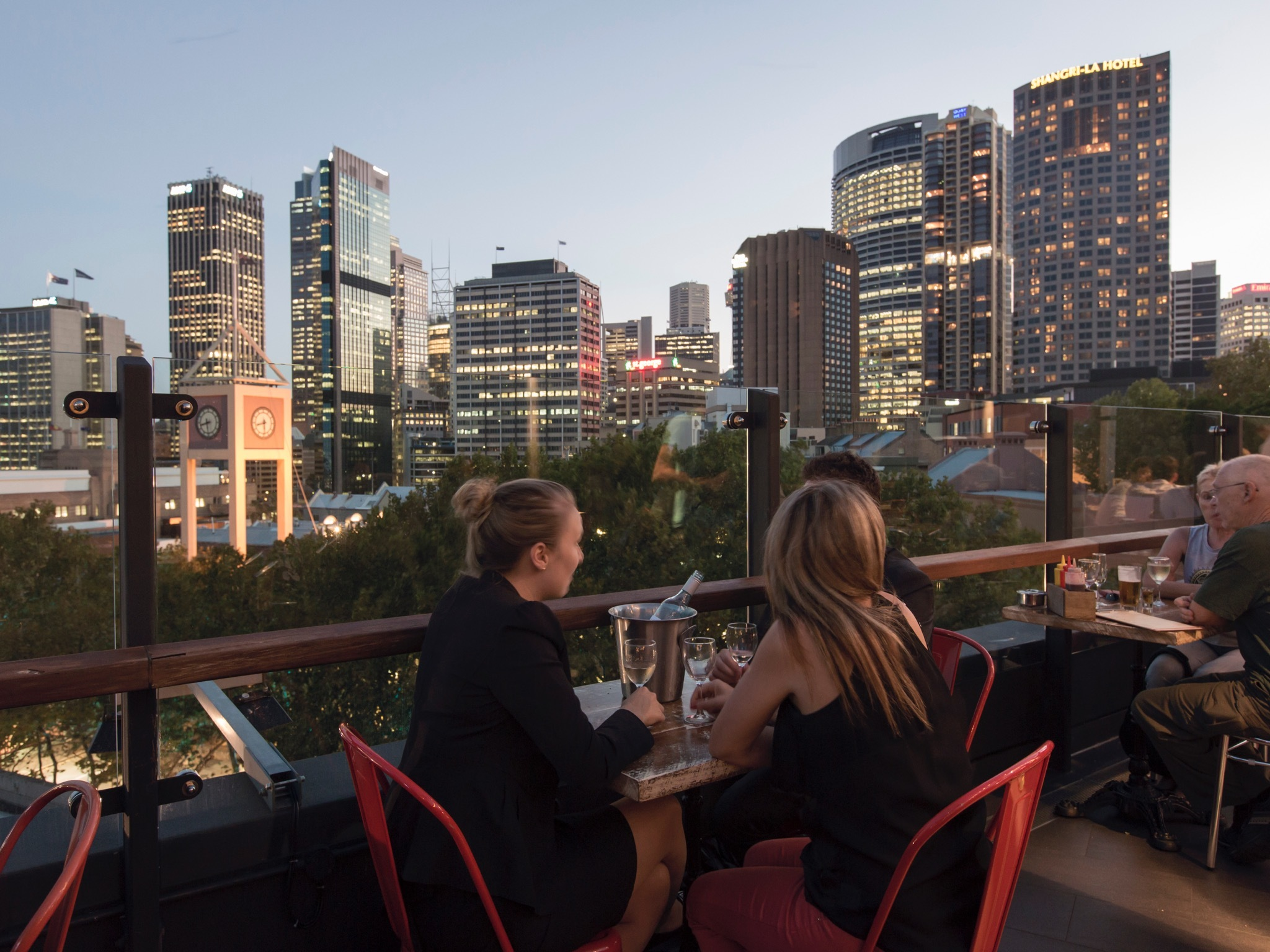 People drinking with a view of the city
