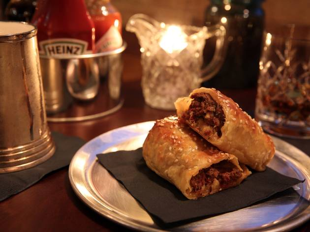 A shot of two sausage rolls on a metal plate at The Wild Rover
