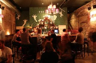 An interior shot at The Wild Rover showing the bar with a large