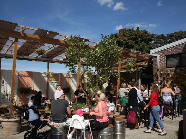 An exterior shot of the beer garden at The Henson showing people
