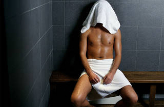 Generic image of a man with His Head Covered in a Sauna