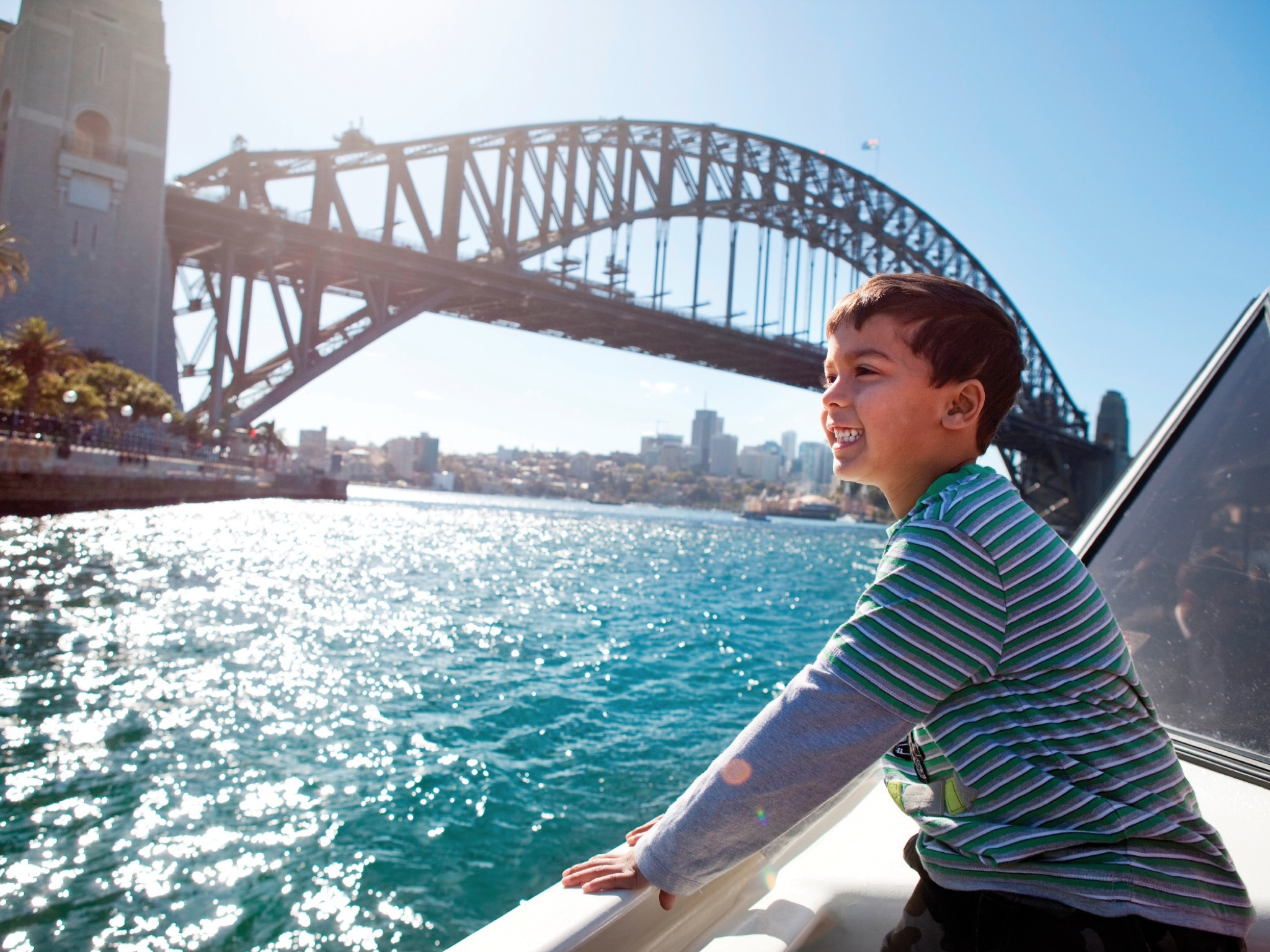 Young boy looking over Sydney harbour