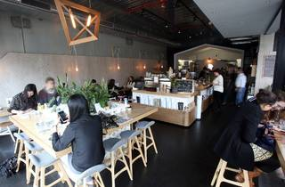 An interior shot of Stovetop showing people sitting at tables ea