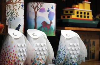 A close up shot of three paper owls at Tree Top Toys