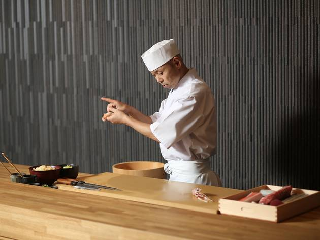 A shot of chef Koichi Minamishima behind the counter preparing f