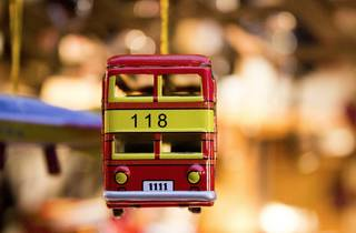 A toy bus hanging in a store