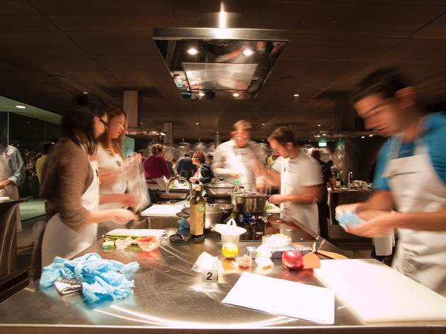 A shot of a class at Sydney Seafood School with people working o