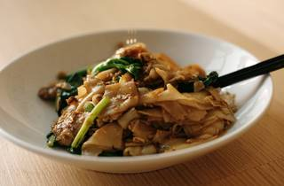Pork pad siew with a pair of chopsticks