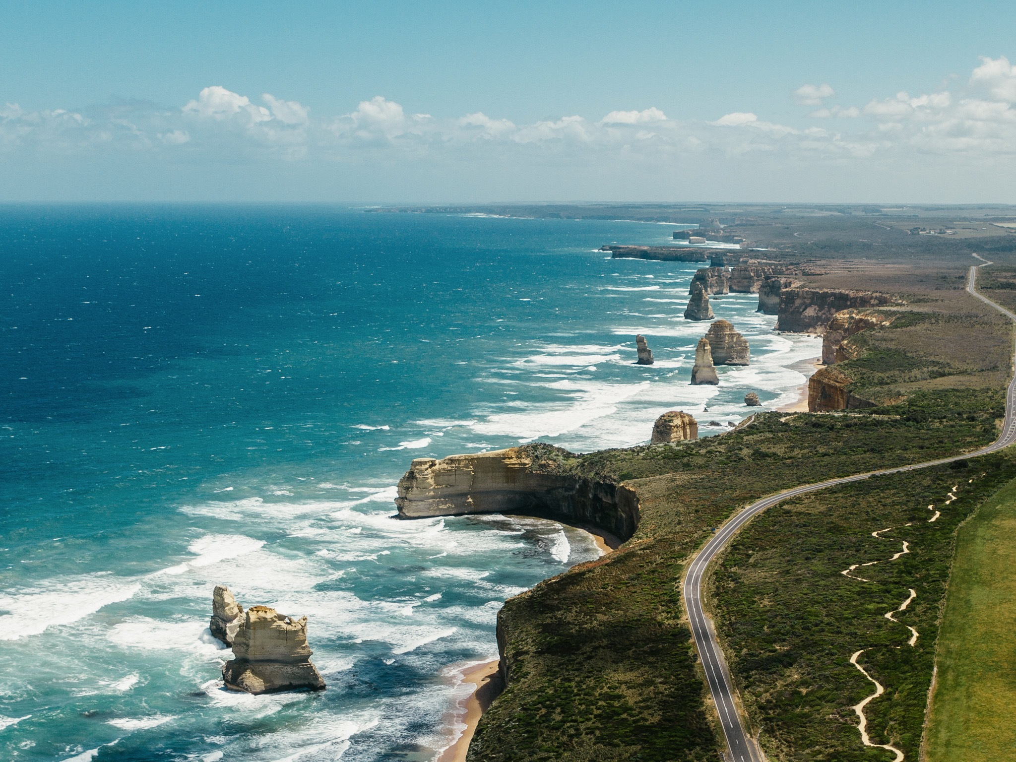 An aerial shot of the twelve apostles along the Great Ocean Road