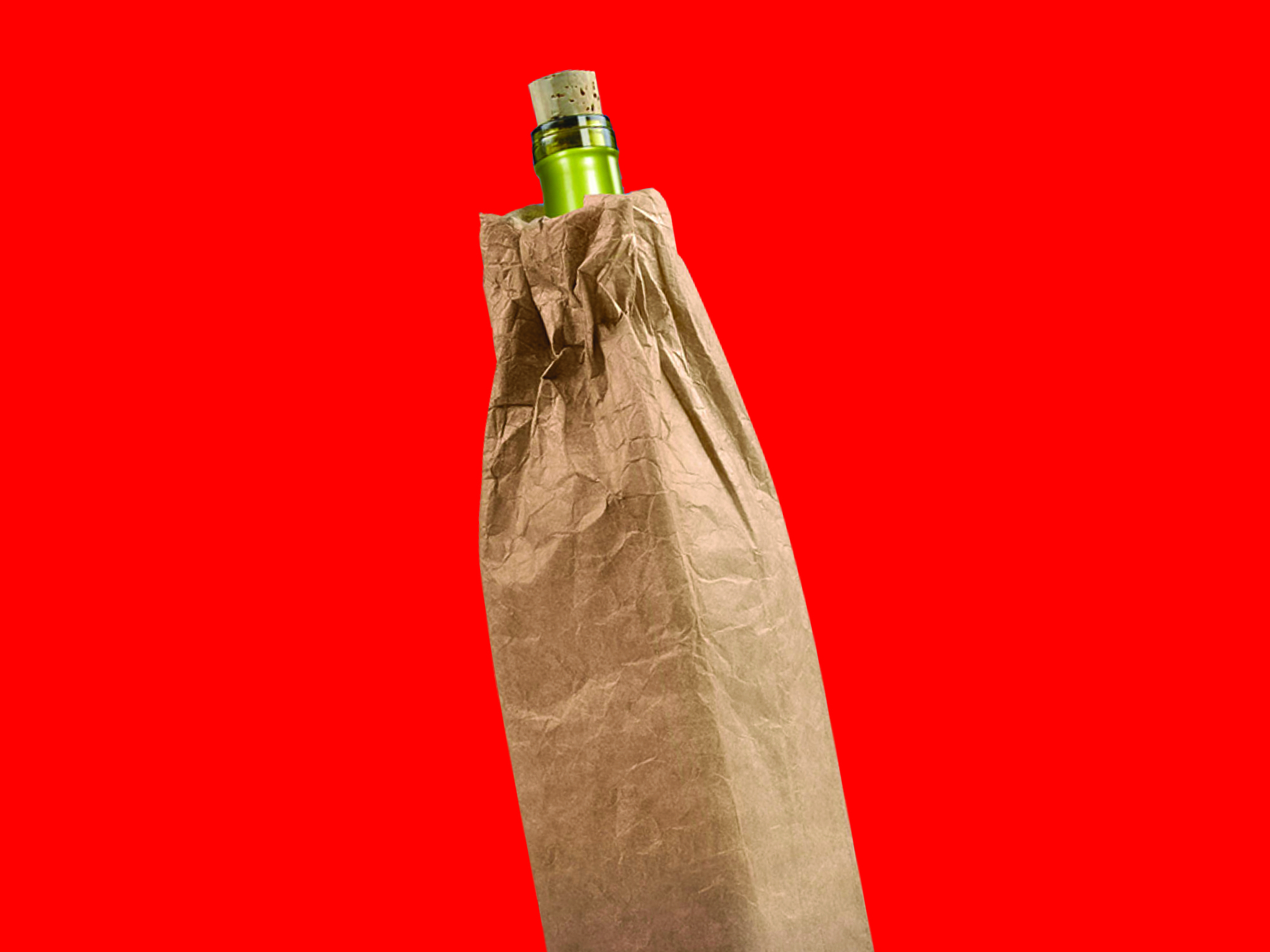 A genetic wine bottle with cork in a brown paper bag