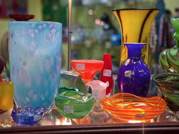 A close up shot of various colourful glass vases of differing si