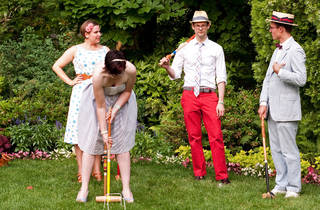 People playing croquet in the sun