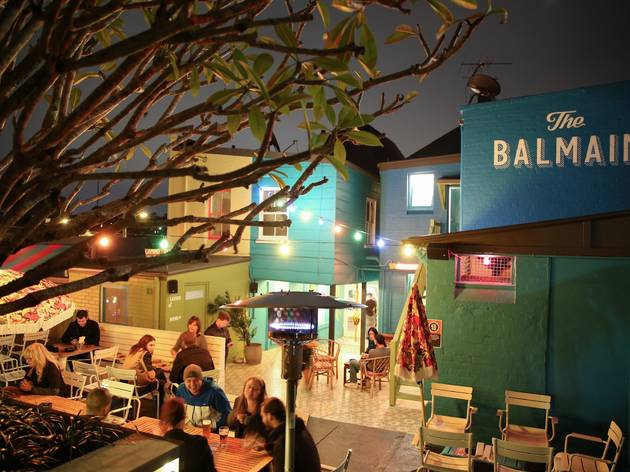 A shot of the back courtyard at Balmain Hotel showing people sit