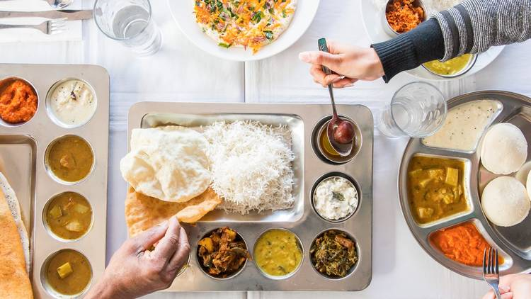 A top down shot of Thali at Janani. Multiple hands are in frame