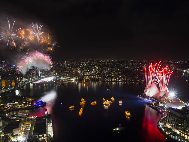 Aerial shot of Sydney Harbour as the fireworks go off on New Year's Eve