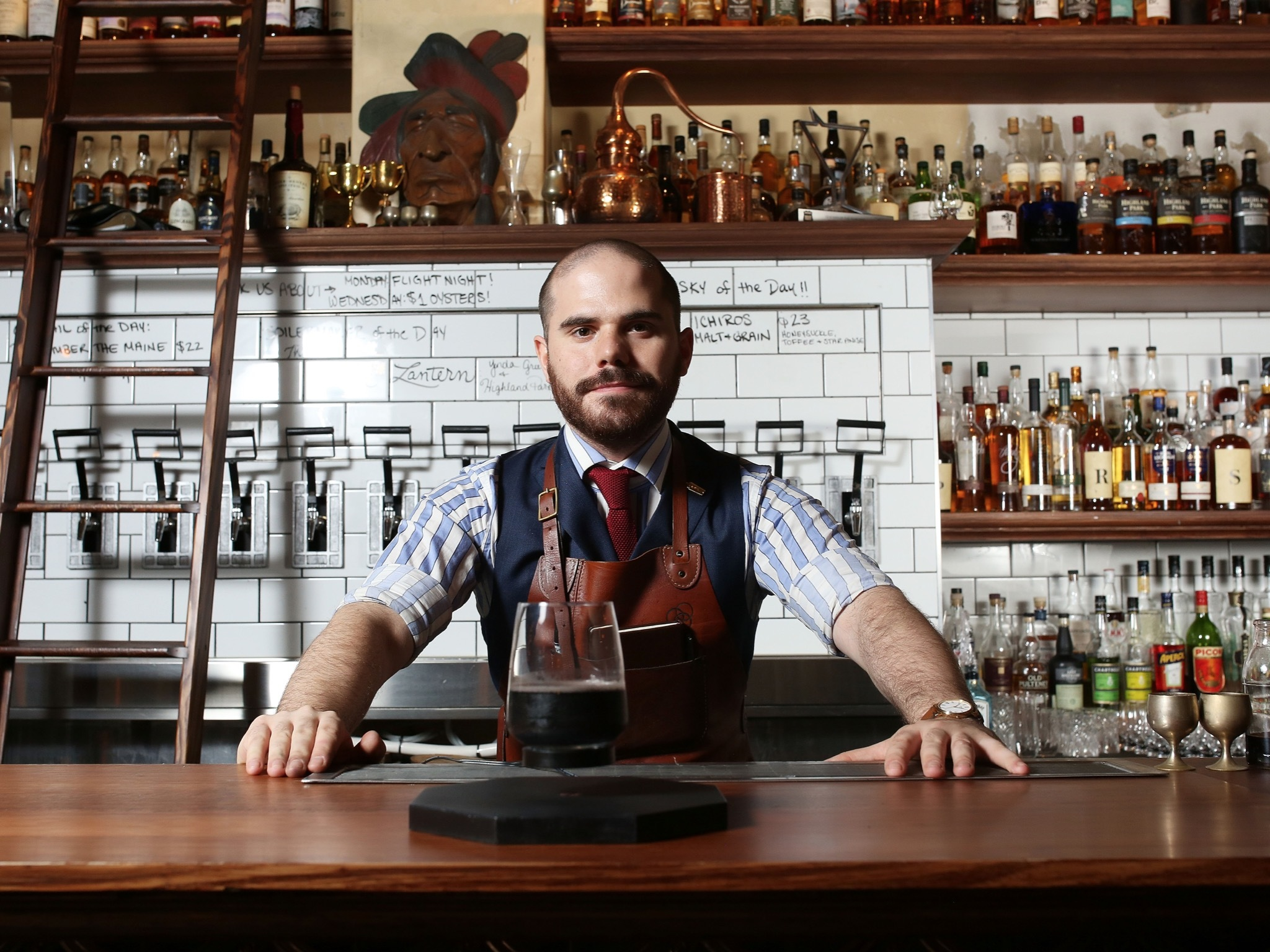 A portrait shot of bartender Jack Sotti behind the bar at Boiler