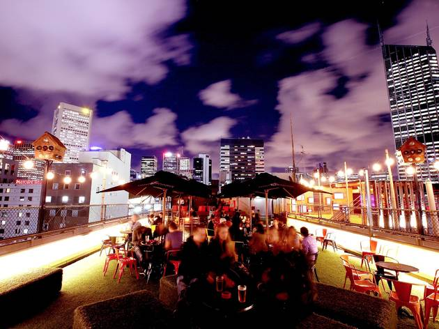 A shot of the rooftop at Rooftop Bar showing people sitting at t