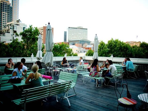 A shot of the rooftop at Madame Brussels showing people sitting