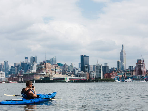 Snapping a shot of the Empire State Building from a kayak