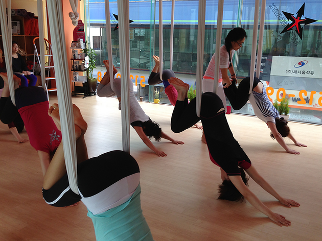 Flying yoga, aerial yoga, AntiGravity yoga—what's what?