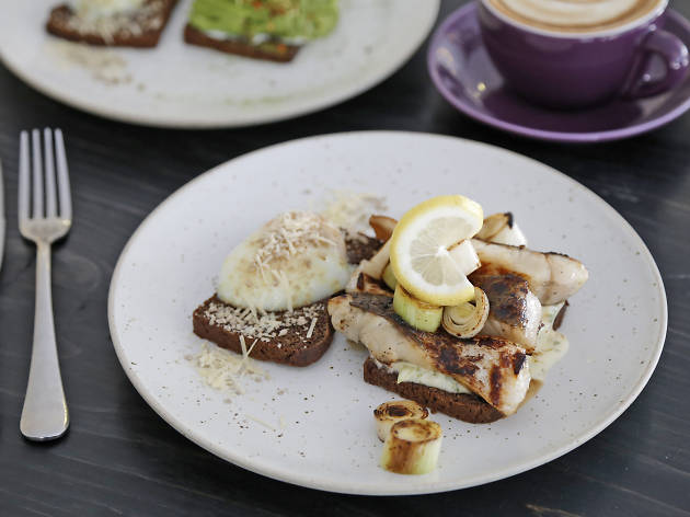 Toast + grilled honeyed sea bass + leeks + poached egg + feta cheese + toasted nuts at THIRDWAVE